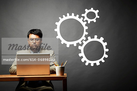 Conceptual image of man as cog in the wheel Stock Photo - Premium Royalty-Free, Image code: 614-06898222