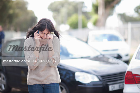 Woman crying after car accident Stock Photo - Premium Royalty-Free, Image code: 614-06973593
