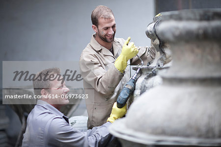 Putting harness on large vases Stock Photo - Premium Royalty-Free, Image code: 614-06973623