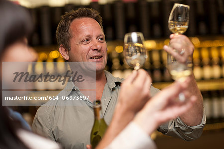 Wine tasting at wine growers shop Stock Photo - Premium Royalty-Free, Image code: 614-06973697