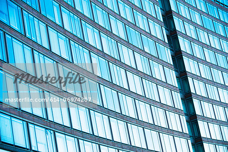 Abstract of office building with curved facade Stock Photo - Premium Royalty-Free, Image code: 614-06974207