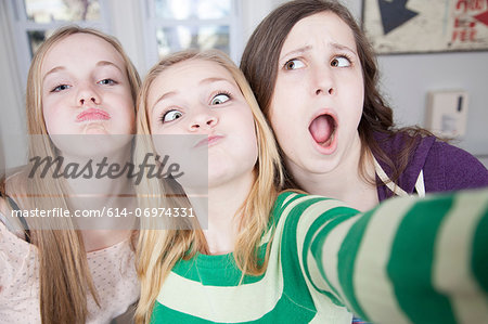 Teenagers pulling funny faces Stock Photo - Premium Royalty-Free, Image code: 614-06974331