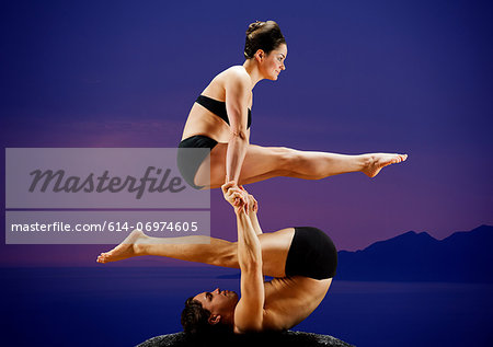 Mid adult dancers performing together at dusk Stock Photo - Premium Royalty-Free, Image code: 614-06974605