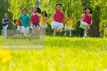Children running on grass Stock Photo - Premium Royalty-Free, Image code: 614-07031199