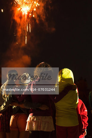 Group of people watching firework display Stock Photo - Premium Royalty-Free, Image code: 614-07031244