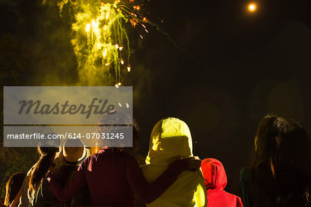 Group of people watching firework display Stock Photo - Premium Royalty-Free, Image code: 614-07031245