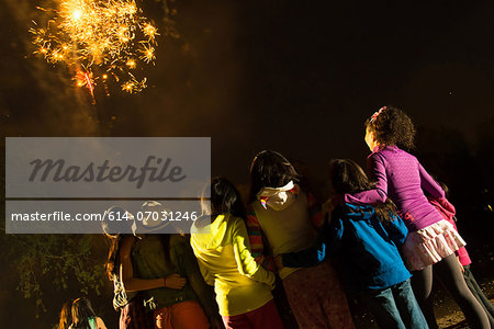 Group of people watching firework display Stock Photo - Premium Royalty-Free, Image code: 614-07031246