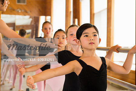 Ballerinas practising at the barre in ballet school Stock Photo - Premium Royalty-Free, Image code: 614-07031251