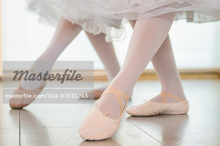 Ballerinas practising together, low section Stock Photo - Premium Royalty-Free, Image code: 614-07031263