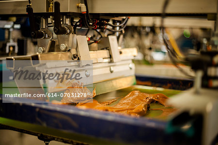Screen print machine spreading ink on frame Stock Photo - Premium Royalty-Free, Image code: 614-07031278