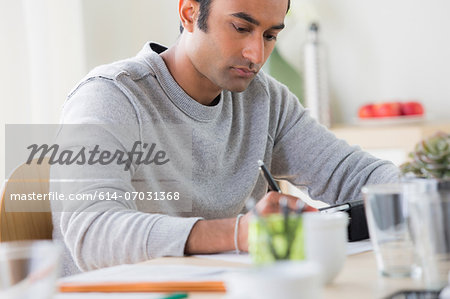 Young man working in office Stock Photo - Premium Royalty-Free, Image code: 614-07031368