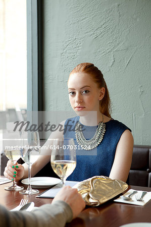 Young woman in restaurant Stock Photo - Premium Royalty-Free, Image code: 614-07031524
