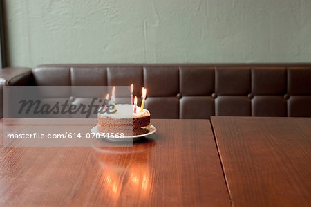 Birthday cake on table in restaurant Stock Photo - Premium Royalty-Free, Image code: 614-07031568
