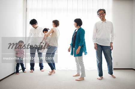 Three generation family by window Stock Photo - Premium Royalty-Free, Image code: 614-07031609