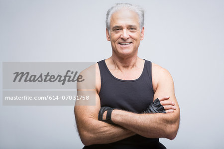 Senior man in sports clothing with arms crossed, portrait Stock Photo - Premium Royalty-Free, Image code: 614-07031758