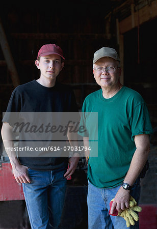 Mature farmer and son in barn, portrait Stock Photo - Premium Royalty-Free, Image code: 614-07031794