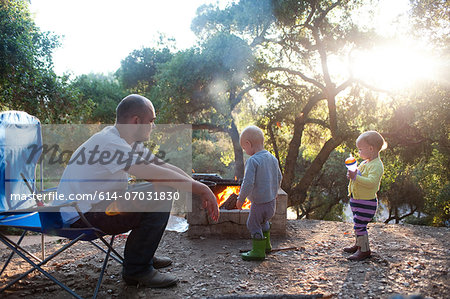 Toddler twins on camping site with father Stock Photo - Premium Royalty-Free, Image code: 614-07031830