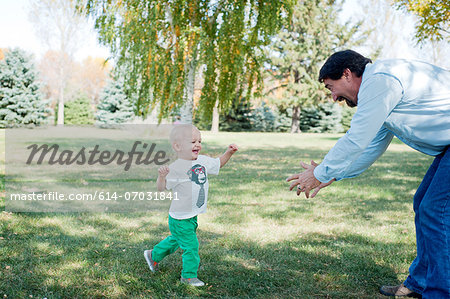 Grandfather playing with grandson in park Stock Photo - Premium Royalty-Free, Image code: 614-07031841