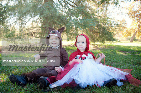 Toddler twins in woods dressed up as red riding hood and wolf Stock Photo - Premium Royalty-Free, Image code: 614-07031858
