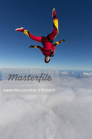 Female skydiver free falling upside down Stock Photo - Premium Royalty-Free, Image code: 614-07031893