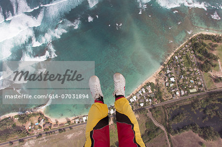 Legs and feet of skydiver above coastline Stock Photo - Premium Royalty-Free, Image code: 614-07031894