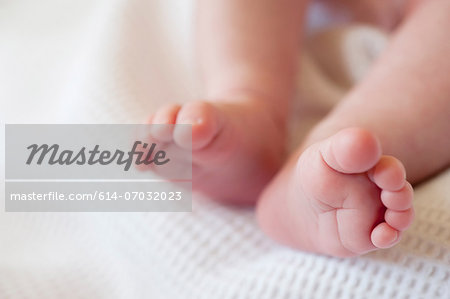 Baby girl's barefeet, close up Stock Photo - Premium Royalty-Free, Image code: 614-07032023