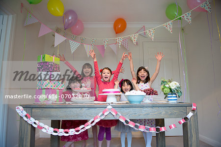Girls cheering at birthday party Stock Photo - Premium Royalty-Free, Image code: 614-07032030