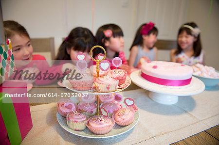 Fairy cakes at girl's birthday party Stock Photo - Premium Royalty-Free, Image code: 614-07032037