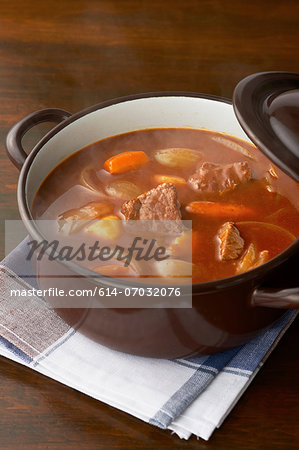 Still life of meat and vegetables in casserole dish Stock Photo - Premium Royalty-Free, Image code: 614-07032076