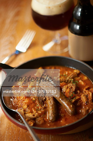 Still life with sausage stew and beer Stock Photo - Premium Royalty-Free, Image code: 614-07032103