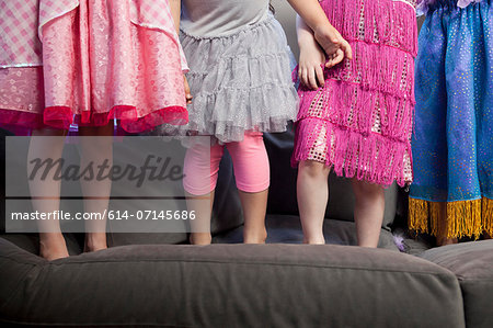 Children standing on sofa Stock Photo - Premium Royalty-Free, Image code: 614-07145686