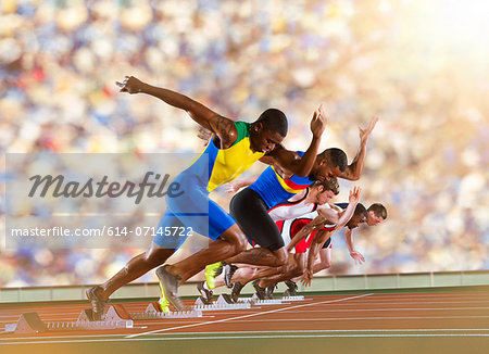 Five athletes starting a sprint race Stock Photo - Premium Royalty-Free, Image code: 614-07145722