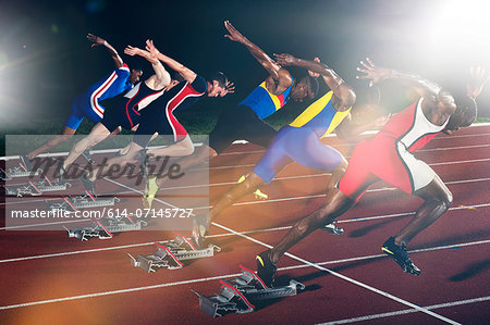 Six athletes starting race at night Stock Photo - Premium Royalty-Free, Image code: 614-07145727