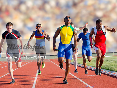 Six athletes running race Stock Photo - Premium Royalty-Free, Image code: 614-07145728