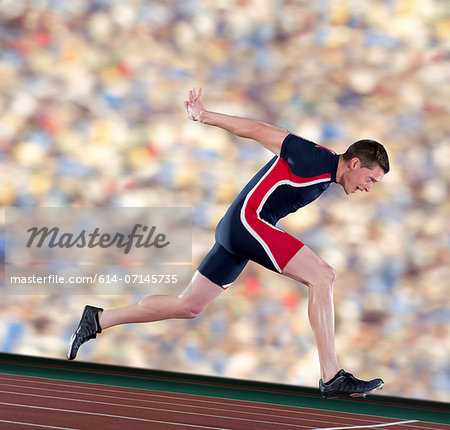 Athlete finishing race Stock Photo - Premium Royalty-Free, Image code: 614-07145735