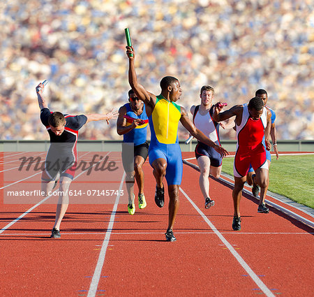 Six athletes running relay race Stock Photo - Premium Royalty-Free, Image code: 614-07145743