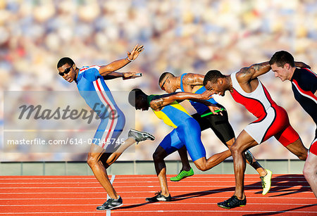 Five athletes running relay race Stock Photo - Premium Royalty-Free, Image code: 614-07145745