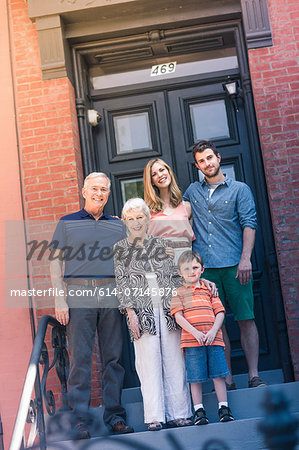 Portrait of three generation family outside front door Stock Photo - Premium Royalty-Free, Image code: 614-07145876