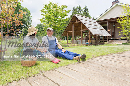 Couple relaxing on lawn Stock Photo - Premium Royalty-Free, Image code: 614-07145951