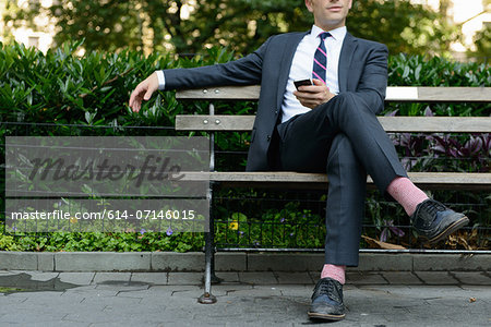Businessman relaxing on bench Stock Photo - Premium Royalty-Free, Image code: 614-07146015