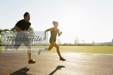 Couple running in city park early morning Stock Photo - Premium Royalty-Free, Image code: 614-07146074