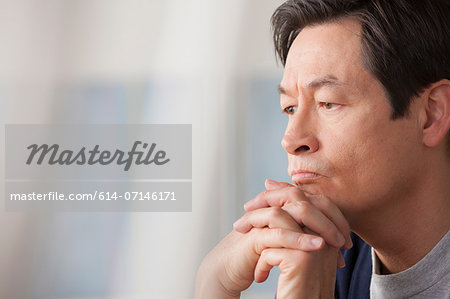 Mature man with hands on chin Stock Photo - Premium Royalty-Free, Image code: 614-07146171
