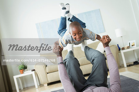 Father lifting son on feet Stock Photo - Premium Royalty-Free, Image code: 614-07146268