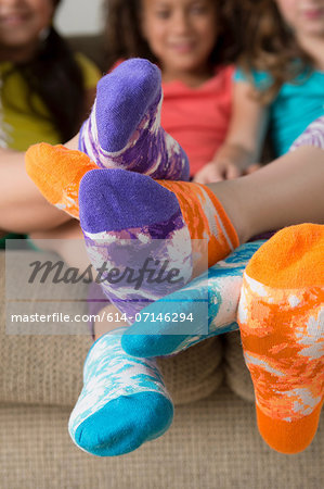 Girls wearing brightly coloured socks Stock Photo - Premium Royalty-Free, Image code: 614-07146294