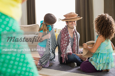Girls dressing up father Stock Photo - Premium Royalty-Free, Image code: 614-07146313