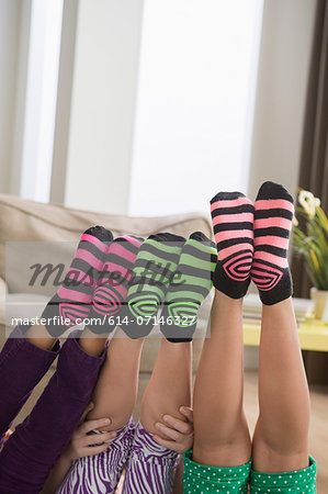 Three girls wearing brightly coloured socks Stock Photo - Premium Royalty-Free, Image code: 614-07146327