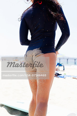 Close up of female surfer, Hermosa Beach, California, USA Stock Photo - Premium Royalty-Free, Image code: 614-07146460