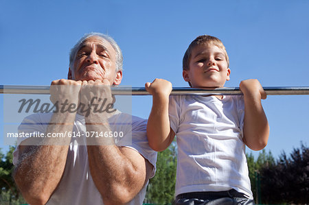 Man and grandson doing chin-ups Stock Photo - Premium Royalty-Free, Image code: 614-07146500