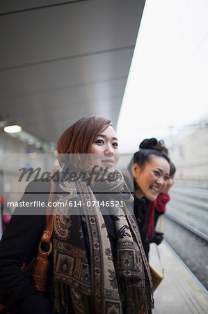Young women waiting for train Stock Photo - Premium Royalty-Free, Image code: 614-07146521