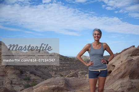 Woman standing at Vazquez Rocks with hands on hips Stock Photo - Premium Royalty-Free, Image code: 614-07194347
